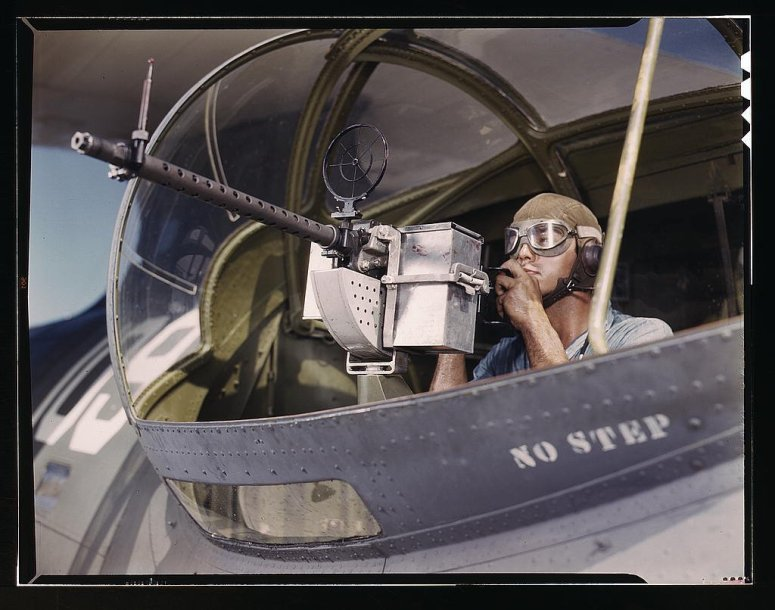 jesse-rhodes-waller-aom-third-class-tries-out-a-30-calibre-machine-gun-he-has-just-installed-on-a-navy-plane-naval-air-base-corpus-christi-texas